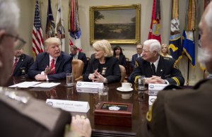 President Donald Trump speaks alongside Sheriff Carolyn Bunny Welsh, center, of Chester County, Pennsylvania, and Sheriff Harold Eavenson, right, of Rockwall County, Texas, during a meeting with county sheriffs in the Roosevelt Room of the White House in Washington, D.C., on Feb. 7, 2017. (Credit: SAUL LOEB/AFP/Getty Images)