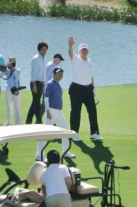 President Donald Trump waves beside Japan's Prime Minister Shinzo Abe while playing golf in Florida on Feb. 11, 2017. (Credit: JIJI PRESS/AFP/Getty Images)