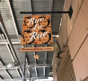 """The sign outside Rue La Rue Cafe in New York City carries a line from """"The Golden Girls"""" theme song, """"Thank You for Being a Friend. (Credit: CNN)"""
