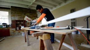 Workers rush to finish flooring for homes meant to hide immigrants. (Credit: Tom Larson/CNN)