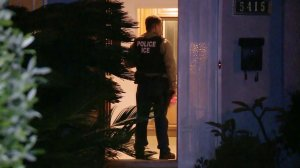 In this file photo, an ICE agent is seen during an operation in Los Angeles. (Credit: Michael Johnson / U.S. Immigration and Customs Enforcement