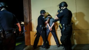 Anaheim police arrest a protester. Police said at least 24 people were arrested during demonstrations Wednesday night. (Credit: Marcus Yam / Los Angeles Times)