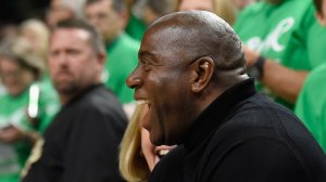 Owner Magic Johnson of the Los Angeles Sparks laughs with a fan before Game Five of the 2016 WNBA Finals against the Minnesota Lynx on Oct. 11, 2016, at Target Center in Minneapolis. (Credit: Hannah Foslien/Getty Images)