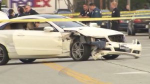 A white Mercedes is shown after it had collided with several other cars following a police pursuit on Feb. 8, 2017. (Credit: KTLA)