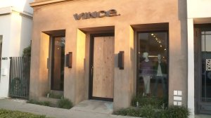 The front door to Vince is boarded up after the business was vandalized on Feb. 1, 2017. (Credit: KTLA)