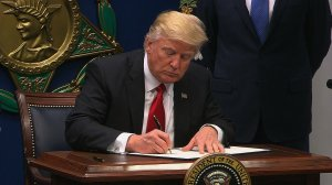 President Donald Trump took executive action on curbing access visas and limiting refugees coming to the US. (Credit: CNN)