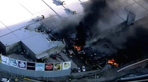 A small chartered plane with five people aboard crashed into a shopping center shortly after takeoff from Melbourne's Essendon airport Tuesday Feb. 21, 2017. (Credit: Seven Network)