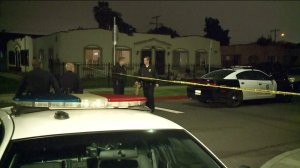 Officers respond to the scene where a 92-year-old man shot his wife on Feb. 14, 2017. (Credit: KTLA)