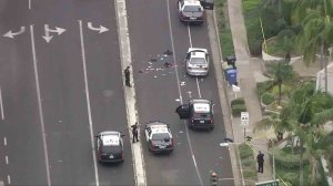An investigation was underway after shootout left a Whittier police officer dead, and another officer and a suspect wounded, authorities said. (Credit: KTLA)