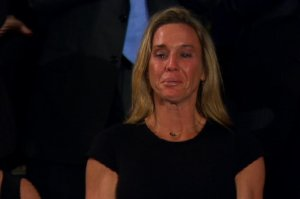 """President Trump honored Carryn Owens, the wife of the late Navy Seal, William """"Ryan"""" Owens. Her husband was killed in a raid in Yemen in January 2017. (Credit: CNN)"""