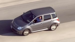 A driver involved in a pursuit is seen gesturing out of the window. (Credit: KTLA)