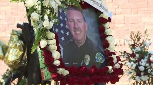 A picture of Keith Boyer is seen at a growing memorial outside the Whittier Police Department on March 2, 2017. (Credit: KTLA)