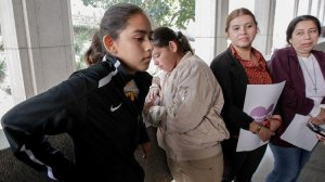 Fatima Avelica, left, with sister Yuleni, mother Norma and aunt Martina Avelica earlier this month at L.A. Superior Court to support her father, Romulo Avelica-Gonzalez, an immigrant who was detained by ICE agents as he drove her to school in Highland Park. (Credit: Irfan Khan / Los Angeles Times)