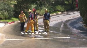 Firefighters respond to flooding in Bel-Air on July 22, 2017. (Credit: KTLA)