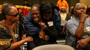 """Lisa Hines, the mother of Wakiesha Wilson, is comforted after the Police Commission determined that no LAPD officers were """"substantially involved"""" in her daughter's death. (Credit: Irfan Khan / Los Angeles Times)"""