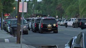 Authorities respond to a barricaded man in Bellflower on Aug. 17, 2017. (Credit: KTLA)