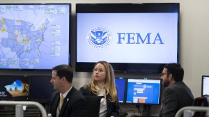 FEMA employees are seen at the agency's Washington, D.C. headquarters shortly before a visit from President Donald Trump on Aug. 4, 2017. (Credit: Michael Reynolds/ Pool/Getty Images)