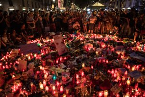 Hundreds gather on Aug. 18, 2017, around tributes laid near the scene of the Barcelona terror attack that left at least 13 dead. (Credit: Carl Court/Getty Images)
