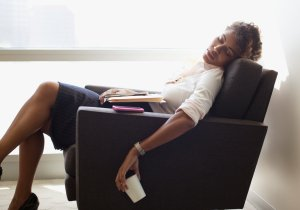 A woman is seen sleeping in an office chair in this file photo. (Credit: Sam Edwards/Getty Images)