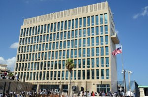 View of the U.S. Embassy building with the US flag raised over it in Havana on August 14, 2015. (Credit: STR/AFP/Getty Images)