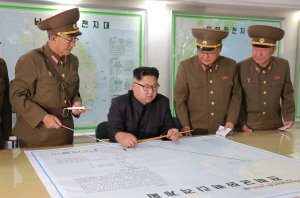 North Korean leader Kim Jong-Un inspects military plans on Aug. 14, 2017. (Credit: Korean Central News Agency via AFP/Getty Images)