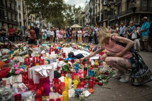 A woman visits a memorial site on Aug. 19, 2017, near the scene of the Barcelona terror attack that left at least 13 people dead. (Credit: Carl Court/Getty Images)