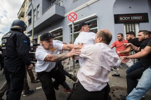 Participants of a Neo-Nazi march clash with counter demonstrators as German police try to break between the sides, on Aug. 19, 2017, in Berlin. (Credit: Omer Messinger / Getty Images)