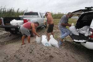 Residents fill sandbags as people prepare for approaching Hurricane Harvey on August 25, 2017 in Corpus Christi, Texas. (Credit: Joe Raedle/Getty Images)