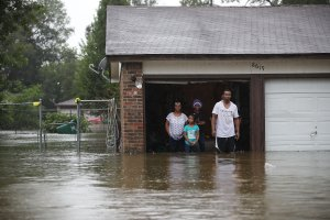 People wait to be rescued from their flooded homes after the area was inundated with flooding from Hurricane Harvey on August 28, 2017 in Houston, Texas. (Credit: Joe Raedle/Getty Images)