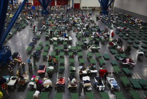 Evacuees fill up cots at the George Brown Convention Center that has been turned into a shelter run by the American Red Cross to house victims of the high water from Hurricane Harvey on August 28, 2017 in Houston. (Credit: Erich Schlegel/Getty Images)