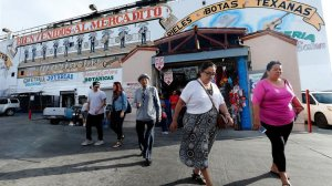 Shoppers exit the El Mercado shopping center in Boyle Heights. A City Council committee has rejected a nonprofit developer's plan to build housing for the homeless nearby. (Credit: Mel Melcon / Los Angeles Times)