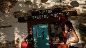 Carl Cavaness and Kiera Freeman joke around outside the trading post in Nipton. (Credit: Marcus Yam / Los Angeles Times)