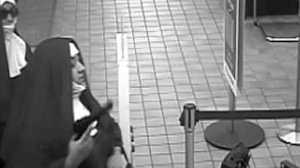 A surveillance image provided by WNEP shows two would-be bank robbers dressed as nuns in Pennsylvania.