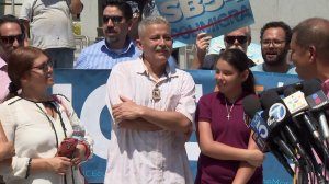 Romulo Avelica-Gonzalez, center, appears outside the Los Angeles County Sheriff's Department headquarters on Aug. 31, 2017, the day after he was released from the custody of U.S. Immigration and Customs Enforcement. (Credit: KTLA)