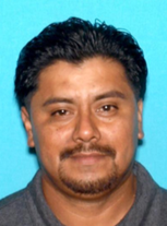 Carlos Omar Pichinte is seen in a booking photo from the Beverly Hills Police Department.