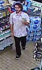 Police released this image of a man sought in connection with an assault and vandalism at a 7-Eleven in Santa Ana.