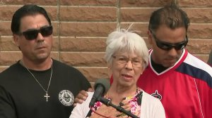 Lucy Hernandez, center, is flanked by her two sons, Steve (left) and Adrian (right), during a news conference about her slain husband on Sept. 13, 2017. (Credit: KTLA)