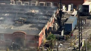 The entire roof of Universal Iron Doors and Hardware in Sun Valley can be seen scorched off after a fire on Sept. 25, 2017. (Credit: KTLA)