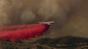 An aircraft drops fire retardant on the Canyon Fire on Sept. 25, 2017. (Credit: KLTA)