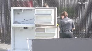 Authorities were investigating after a body was discovered in a fridge left in the middle of a street in Ontario on Sept. 5, 2017. (Credit: OC Hawk)