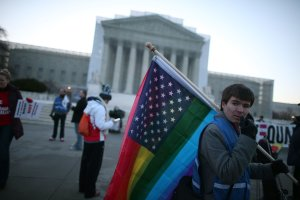 Justin Kenny of Akron Ohio holds a modified Stars and Stripes flag in front of the U.S. Supreme Court, on March 26, 2013, in Washington, DC. (Credit: Mark Wilson / Getty Images)