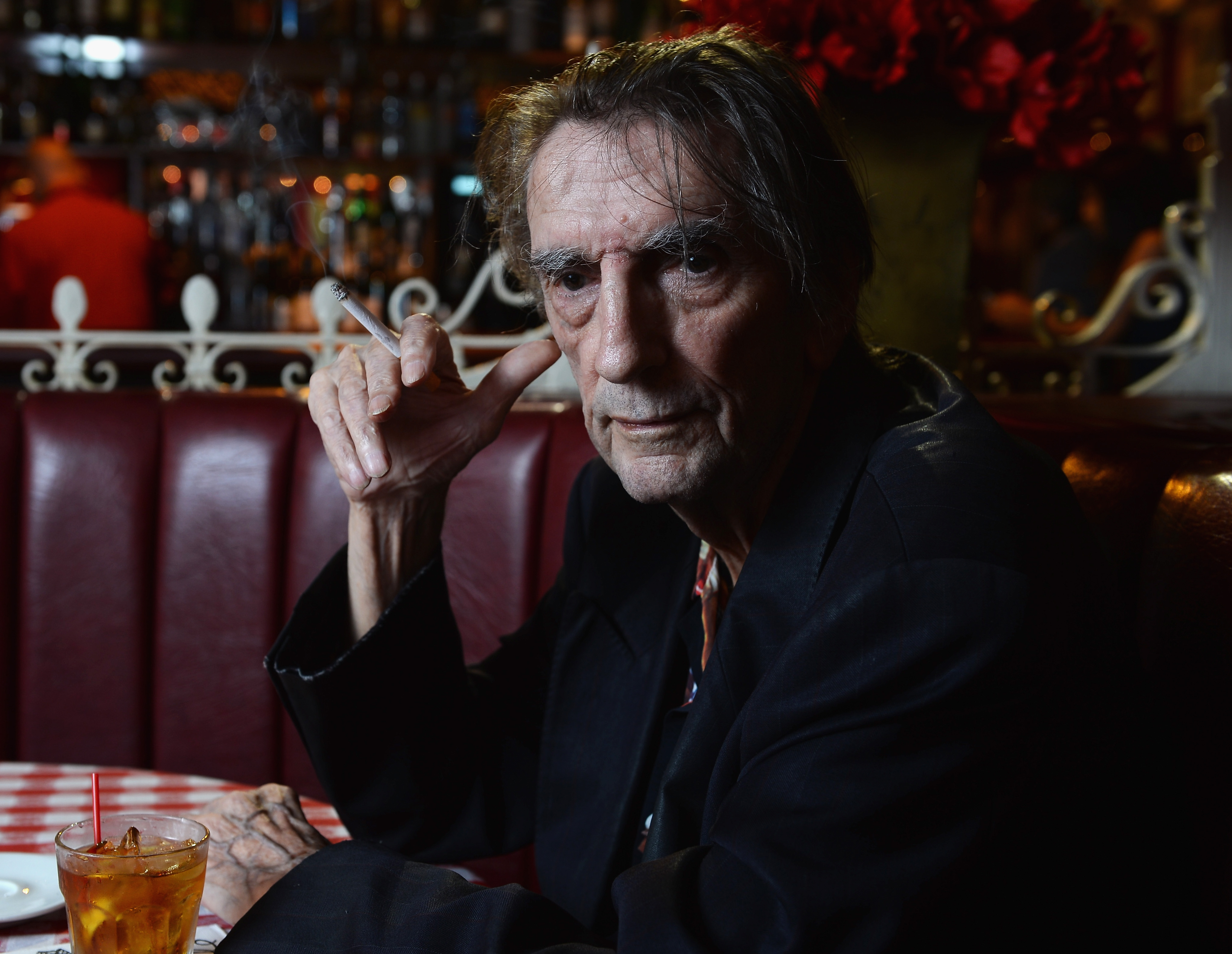 "Actor Harry Dean Stanton poses for a portrait for the film ""Harry Dean Stanton: Partly Fiction"" at Dan Tana's restaurant in West Hollywood on Aug. 22, 2013. (Credit: Michael Buckner/Getty Images)"