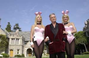 (From left) Sheila Levell, Playboy founder Hugh Hefner and Holly Madison film a commercial for the X Games at the Playboy Mansion in Holmby Hills on May 6, 2003. (Credit: Robert Mora / Getty Images)