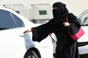 A Saudi woman gets into a taxi at a mall in Riyadh as a grassroots campaign planned to call for an end to the driving ban for women in Saudi Arabia on Oct. 26, 2014. (Credit: FAYEZ NURELDINE/AFP/Getty Images)