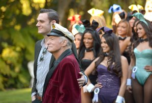 Cooper Hefner, left, and Hugh Hefner pose with women at Playboy's 60th Anniversary event on Jan. 16, 2014, in Holmby Hills. (Credit: Charley Gallay / Getty Images)