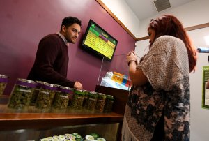 Customers buy marijuana products at the Perennial Holistic Wellness Center, a medicinal marijuana dispensary in Los Angeles on March 24, 2017. (Credit: Mark Ralston / AFP / Getty Images)