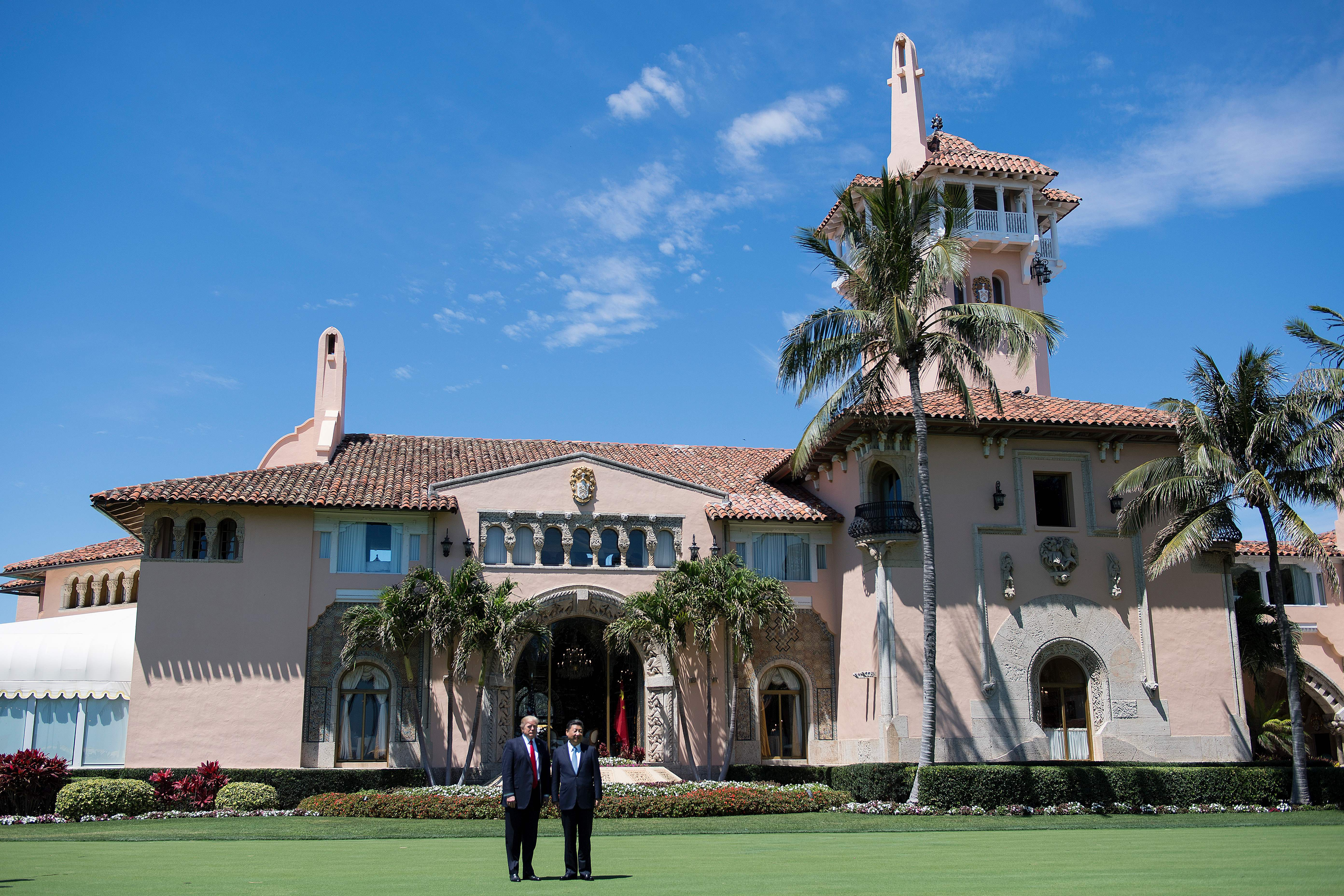 President Donald Trump and Chinese President Xi Jinping pose together at the Mar-a-Lago estate in West Palm Beach, Florida, April 7, 2017. (Credit: JIM WATSON/AFP/Getty Images)
