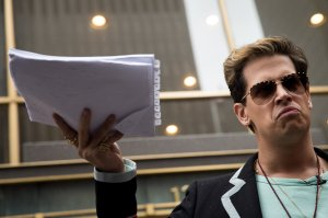 Milo Yiannopoulos holds up a copy of a legal complaint as he speaks outside the offices of Simon & Schuster publishing company after it canceled his book deal, July 7, 2017, in New York City. (Credit: Drew Angerer/Getty Images)