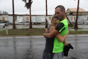 Two people hug after riding out Hurricane Harvey in an apartment on Aug. 26, 2017, in Rockport, Texas. (Credit: Joe Raedle/Getty Images)