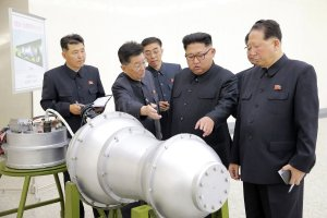 This undated picture released by North Korea's official Korean Central News Agency (KCNA) on Sept. 3, 2017, shows North Korean leader Kim Jong-Un looking at a metal casing at an undisclosed location. (Credit: STR / AFP / Getty Images)